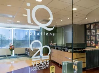 A glass door in the lobby of IQ Solutions.