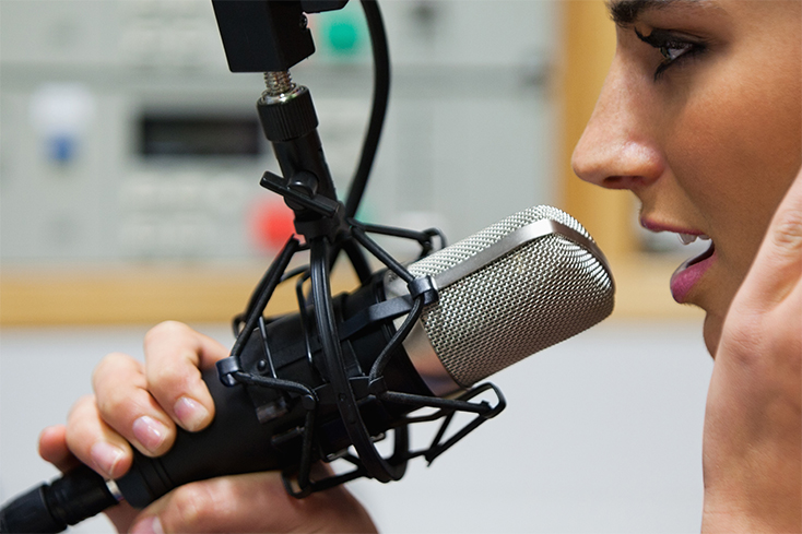 A woman speaking into a microphone.