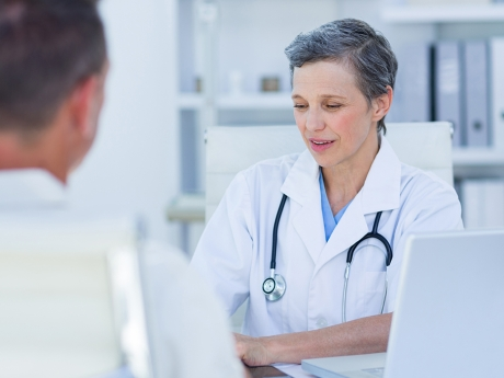 A female doctor speaking with a patient.