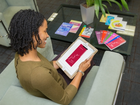A woman using a tablet.